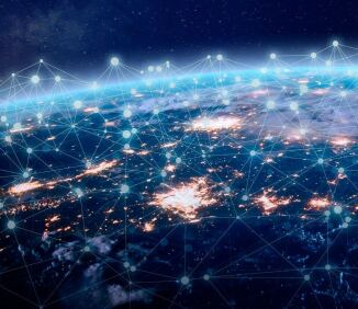 View from space of a connected network around planet Earth representing the Internet of Things.