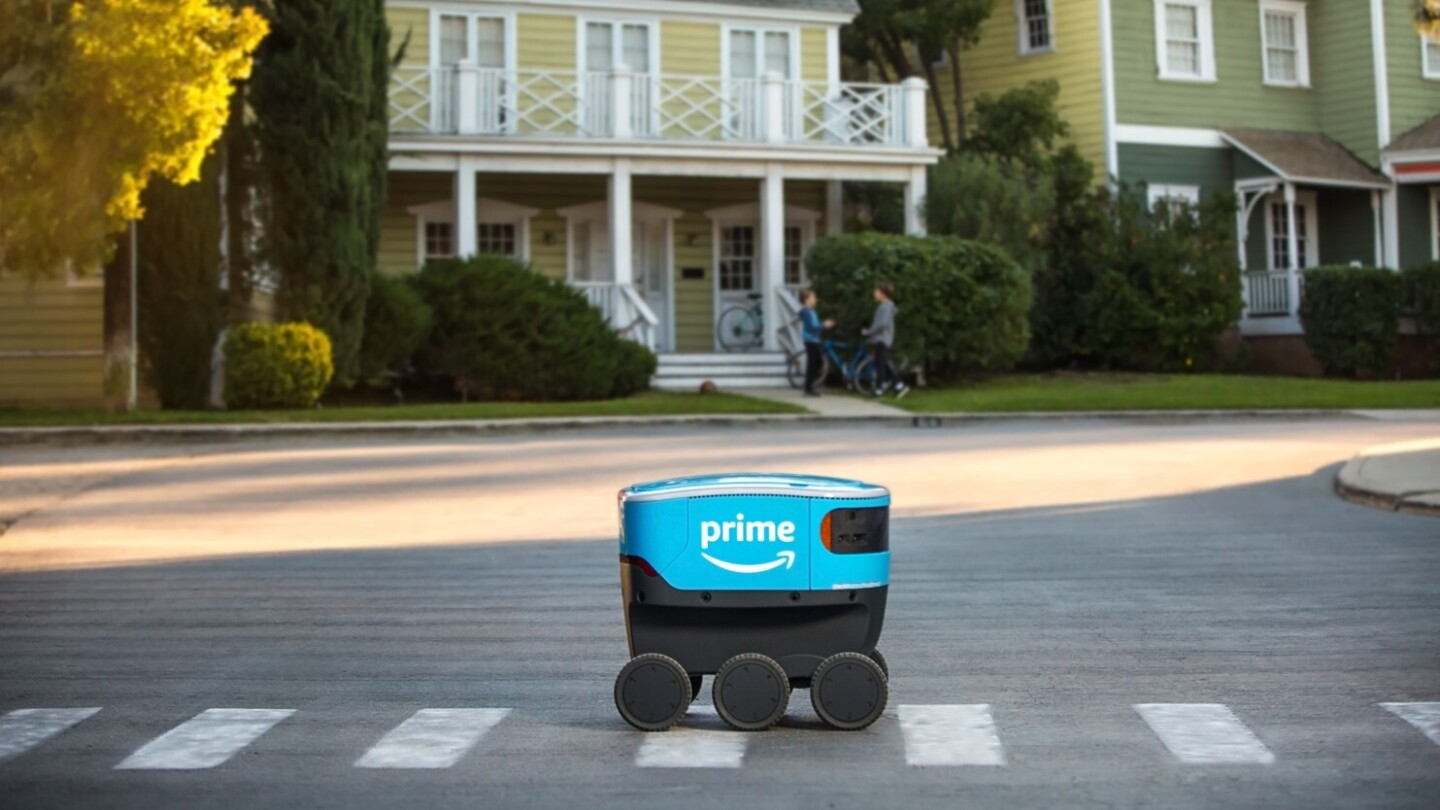 Amazon Scout making a delivery in a residential neighborhood.