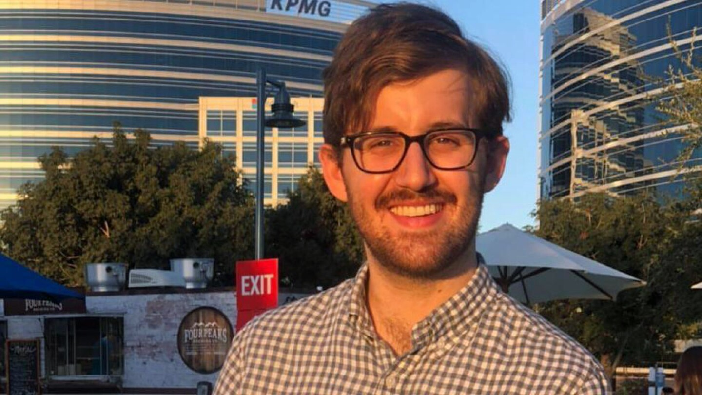 Image shows Amazon science intern Michael Saxon standing in front of two office buildings