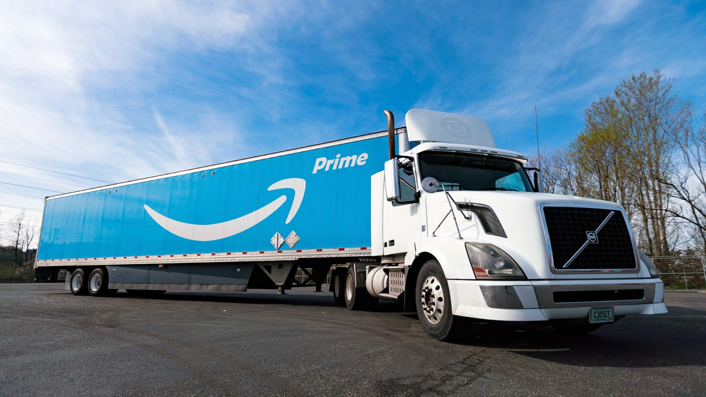 The photo shows an Amazon truck parked with the company logo and the word prime painted on the side