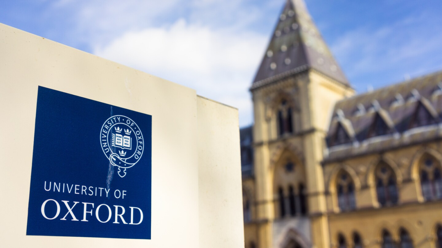 The University of Oxford insignia on a sign outside the Pitt Rivers Museum, which houses the university's anthropological and archaeological collections