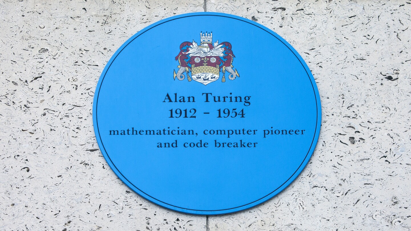 A blue plaque at Kings College in Cambridge commemorating former student and computer pioneer Alan Turing